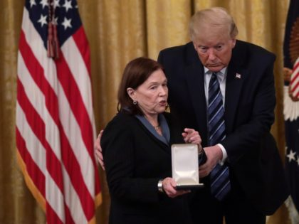 WASHINGTON, DC - NOVEMBER 07: U.S. President Donald Trump presents the Presidential Citizens Medal to Susan Rescorla, wife of Richard Cyril Rescorla, during an East Room event at the White House November 7, 2019 in Washington, DC. Richard Cyril Rescorla, former director of security for Morgan Stanley, was awarded the …