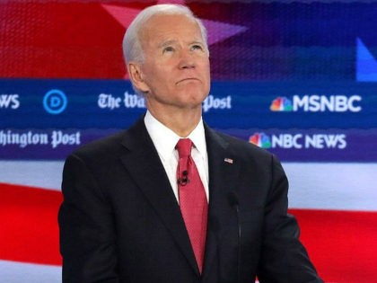 ATLANTA, GEORGIA - NOVEMBER 20: Former Vice President Joe Biden (L) listens as Sen. Bernie Sanders (I-VT) speaks during the Democratic Presidential Debate at Tyler Perry Studios November 20, 2019 in Atlanta, Georgia. Ten Democratic presidential hopefuls were chosen from the larger field of candidates to participate in the debate …