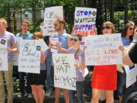 Protesters hold signs and shout slogans outside a Chick-fil-A food truck in a mid-day demonstration organized by the Human Rights Campaign in Washington on 26 July, 2012 after the fast-food firm's president Dan Cathy came out against marriage equality in the United States. The protesters accused Chick-fil-A of a long …