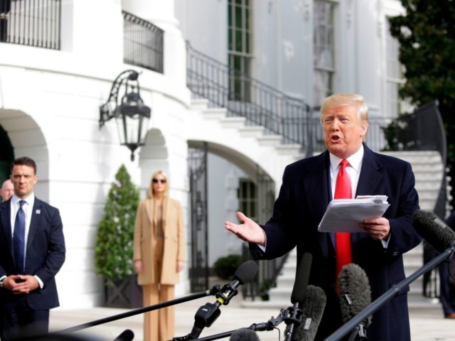 US President Donald Trump reads from his notes as he talks to the media on the South Lawn of the White House before boarding Marine One in Washington, DC, November 20, 2019, en route to Austin, Texas. (Photo by Joshua Lott / AFP) (Photo by JOSHUA LOTT/AFP via Getty Images)