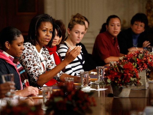 WASHINGTON - NOVEMBER 02: First lady Michelle Obama (C) speaks to a group of female students during an event to kick off a White House leadership and mentoring initiative in the State Dining Room at the White House November 2, 2009 in Washington, DC. The program provides local high school …