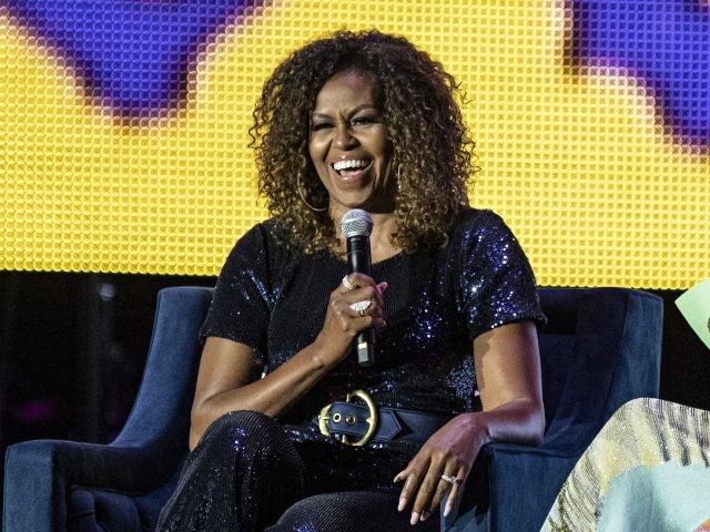 Michelle Obama and Gayle King seen at the 2019 Essence Festival at the Mercedes-Benz Superdome, Saturday, July 6, 2019, in New Orleans. (Photo by Amy Harris/Invision/AP)