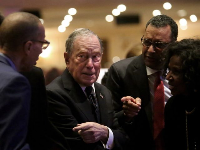 NEW YORK, NY - NOVEMBER 17: Michael Bloomberg (center) prepares to speak at the Christian Cultural Center on November 17, 2019 in the Brooklyn borough of New York City. Reports indicate Bloomberg, the former New York mayor, is considering entering the crowded Democratic presidential primary race. (Photo by Yana Paskova/Getty …