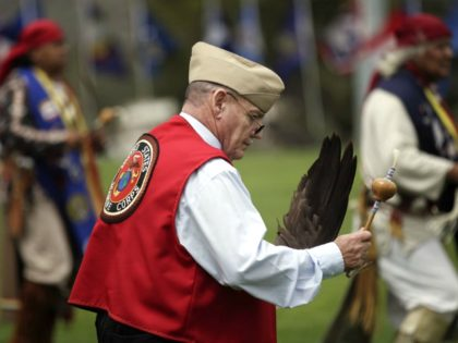"""FILE - In this June 15, 2012, file photo, Jerry Best, a Vietnam War veteran of the Cheyenne tribe, dances on during a Native American blessing for veteran and active-duty servicemen in Camp Pendleton, Calif. """"The Warrior Tradition,"""" a new film set to air on most PBS stations Monday, Nov. …"""