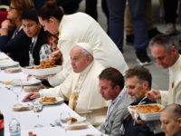 Pope Francis (C) has a lunch with people, on November 17, 2019, at the Paul VI audience hall in Vatican, to mark the World Day of the Poor. (Photo by Vincenzo PINTO / AFP) (Photo by VINCENZO PINTO/AFP via Getty Images)