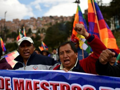 Supporters of Bolivian ex-President Evo Morales march during a protest from El Alto to La Paz on November 13, 2019. - Bolivian senator Jeanine Anez proclaimed herself Bolivia's interim president on the eve, in an effort to fill the power vacuum left by the abrupt resignation of Evo Morales, who …