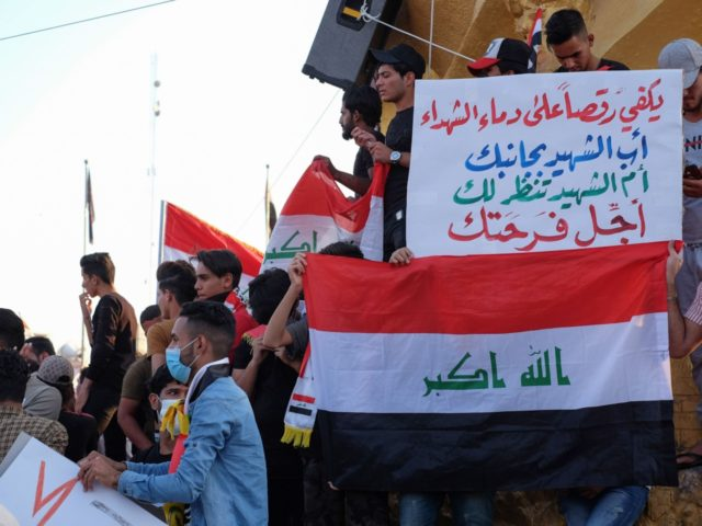 Iraqi protesters gather during ongoing anti-government demonstrations in the Shiite shrine city of Karbala, south of Iraq's capital Baghdad, on November 2, 2019. - Iraqi security forces clashed with anti-government protesters near the capital's Tahrir Square today as anti-government rallies which have rocked Baghdad for a month cost more lives. …