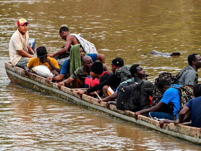 Haitian migrants cross the Chucunaque River by boat to the Temporary Station of Humanitarian Assistance (ETAH) in La Penita village, Darien province, Panama on May 23, 2019. - Migrants mainly from Haiti, Cuba, Democratic Republic of Congo, India, Cameroon, Bangladesh and Angola cross the border between Colombia and Panama through …