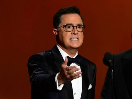 Stephen Colbert (L) and Jimmy Kimmel speak onstage during the 71st Emmy Awards at the Microsoft Theatre in Los Angeles on September 22, 2019. (Photo by Frederic J. BROWN / AFP) (Photo credit should read FREDERIC J. BROWN/AFP via Getty Images)
