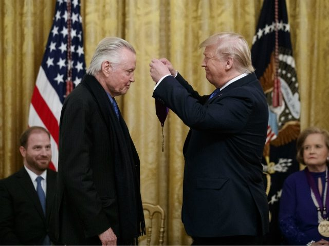 President Donald Trump presents a National Medal of the Arts to actor Jon Voight, during a National Medal of Arts and National Humanities Medal ceremony in the East Room of the White House, Thursday, Nov. 21, 2019, in Washington. (AP Photo/Alex Brandon)