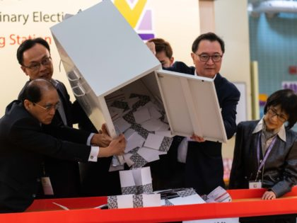 HONG KONG, CHINA - NOVEMBER 24: Barnabus Fung (2nd R) and Patrick Nip Tak-kuen (2nd L) empty a ballot box to count votes at a polling station on November 24, 2019 in Hong Kong, China. Hong Kong held its district council election on Sunday as anti-government protests continue into a …