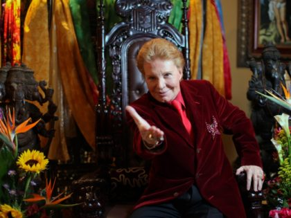 Puerto Rican astrologer Walter Mercado, also known as Shanti Ananda, poses for the camera during a press conference in San Juan, Puerto Rico, Tuesday, Feb. 14, 2012. The famed astrologer who has emerged from a near-death experience due to heart problems has announced that he will create a charitable foundation …