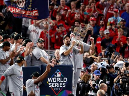 HOUSTON, TEXAS - OCTOBER 30: Anthony Rendon #6 of the Washington Nationals hoists the Commissioners Trophy after defeating the Houston Astros 6-2 in Game Seven to win the 2019 World Series in Game Seven of the 2019 World Series at Minute Maid Park on October 30, 2019 in Houston, Texas. …