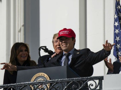 "Baseball player Kurt Suzuki wears a ""Make America Great Again"" hat as US President Donald Trump and First Lady Melania Trump welcome the 2019 World Series Champions, The Washington Nationals, to the White House on November 4, 2019 in Washington,DC. (Photo by NICHOLAS KAMM / AFP) (Photo by NICHOLAS KAMM/AFP …"