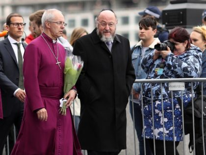 Archbishop of Canterbury Justin Welby (2nd R) and Chief Rabbi Ephraim Mirvis (R) join other faith leaders for a vigil for the victims of the London Bridge terror attacks, in Potters Fields Park on June 5, 2017 in London, England. Seven people were killed and at least 48 injured in …