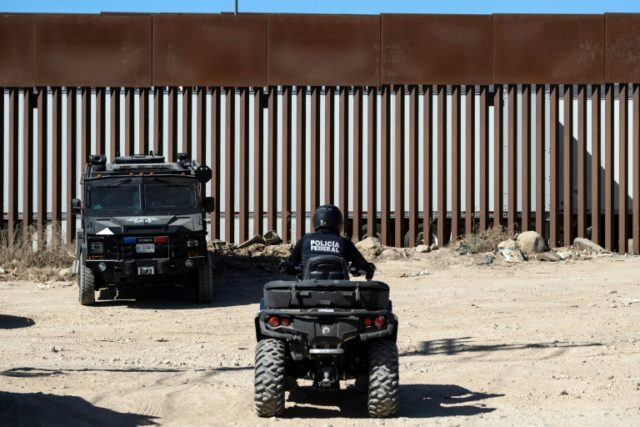 Mexican security forces patrol near the US-Mexico border fence in Tijuana, Mexico, on September 18, 2019