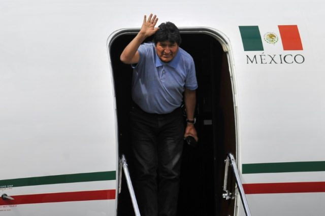 Bolivian ex-President Evo Morales waves upon landing in Mexico City, on November 12, 2019, where he was granted exile after his resignation