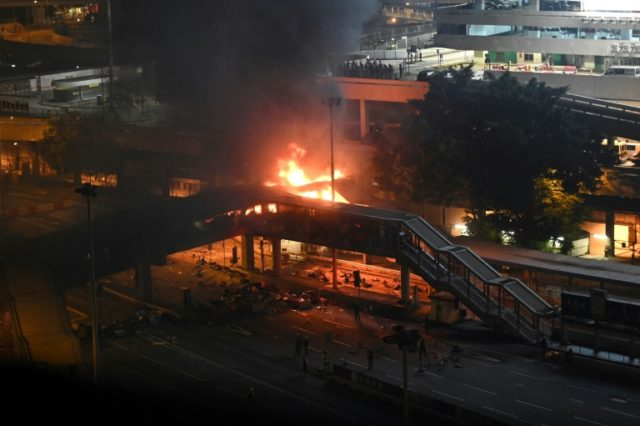 Police tried to retake a footbridge over a tunnel in Hong Kong but were met by a barrage of petrol bombs that caused a huge fire