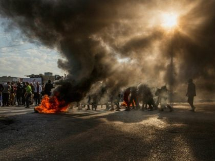 In the oil-rich southern city of Basra, demonstrators blocked main roads just before dawn on Sunday