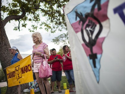 In this May 29, 2014 photo, Denee Mallon, second from left, takes part in the Trans March to Morningside Park in Albuquerque, N.M. A U.S. Department of Health and Services review board ruled Friday, May 30, in favor of Mallon, a 74-year-old Army veteran, whose request to have Medicare pay …
