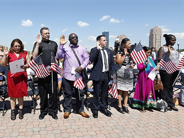A group of people take the oath of allegiance during their naturalization ceremony at Liberty State Park, Monday, July 4, 2016, in Jersey City, N.J. Nearly two dozen new U.S. citizens took their oaths of allegiance at the ceremony. The 21 new citizens came from 17 countries: Bangladesh, Bosnia-Herzegovina, Colombia, …