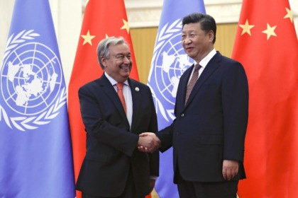 United Nations Secretary-General Antonio Guterres, left, shakes hands with Chinese President Xi Jinping before their bilateral meeting at the Great Hall of the People in Beijing, Sunday, Sept. 2, 2018. (AP Photo/Andy Wong, Pool)