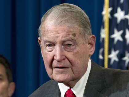 Former FBI director and CIA director William Webster accompanied by his wife Lynda Webster, who were targeted by a man who peddled a lottery scam over phone calls and emails, speaks during a news conference to address elder financial exploitation and law enforcement actions, at Department of Justice in Washington, …