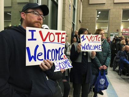 Residents in support of continued refugee resettlement hold signs at a meeting in Bismarck, N.D., Monday Dec. 9. 2019. Several church leaders are urging Burleigh County not to be the nation's first to refuse new refugees since President Donald Trump ordered that states and counties should have the power to …