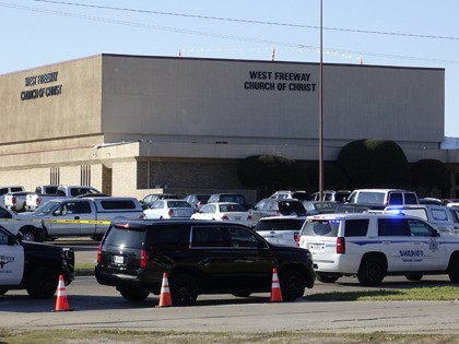 Law enforcement vehicles are seen parked outside West Freeway Church of Christ as authorities continue to investigate a fatal shooting at the church, Sunday, Dec. 29, 2019, in White Settlement, Texas. (AP Photo/David Kent)