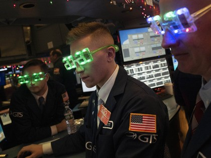 Stock traders wear New Year's 2020 party glasses at New York Stock Exchange, Tuesday, Dec. 31, 2019. Stocks slipped globally in quiet New Year's Eve trading Tuesday with many markets closed. Wall Street could close 2019 with back-to-back daily losses in a year that the U.S. posted the largest market …