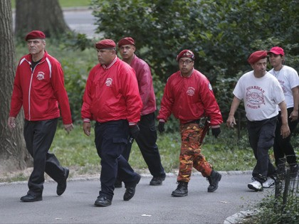 Guardian Angels founder Curtis Sliwa leads members of the Guardian Angles through Central Park Wednesday, Aug. 12, 2015, in New York. Guardian Angels volunteers made a return this month to Central Park for the first time in over two decades, citing a 26 percent rise in crime there so far …