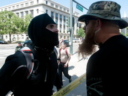 An Antifa demonstrator has a heated exchange with a pro-Trump supporter during the Denver March Against Sharia Law in Denver, Colorado on June 10, 2017.