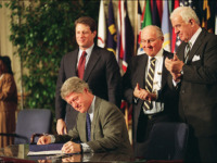 WASHINGTON, : U.S. President Bill Clinton signs the North American Free Trade Agreement (NAFTA) 08 December 1993 as (from left) Vice President Al Gore, House Minority Leader Bob Michel and Speaker of the House Tom Foley watch. The controversial pact will phase out tariffs between the U.S., Mexico, and Canada. …