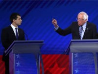 Democratic presidential candidates South Bend, Indiana Mayor Pete Buttigieg and Sen. Bernie Sanders (I-VT) interact during the Democratic Presidential Debate at Texas Southern University's Health and PE Center on September 12, 2019 in Houston, Texas. Ten Democratic presidential hopefuls were chosen from the larger field of candidates to participate in …
