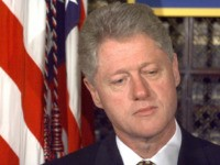 As the US House of Representatives conducts a full vote on whether to proceed with impeachment proceedings, US President Bill Clinton stands to the side as he waits 08 October to be introduced at a medicare beneficiaries event in the Roosevelt Room of the White House in Washington, DC. It …