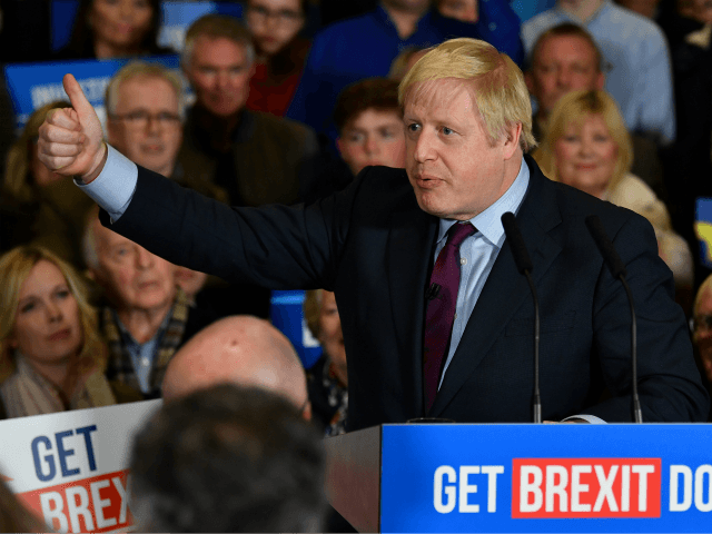 QUEDGELEY, GLOUCESTER, ENGLAND - DECEMBER 09: British Prime Minister and Conservative leader Boris Johnson speaks at a general election campaign rally on December 9, 2019 in Quedgeley, near Gloucester, England. The U.K will go to the polls in a general election on December 12. (Photo by Ben Stansall - WPA …
