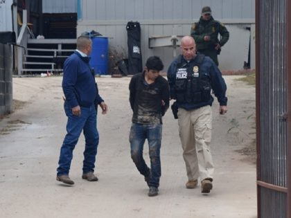 Border Patrol agents and a Homeland Security agent take a migrant into custody during a smuggling operation in Rio Bravo, Texas. (Photo: Bob Price/Breitbart Texas)
