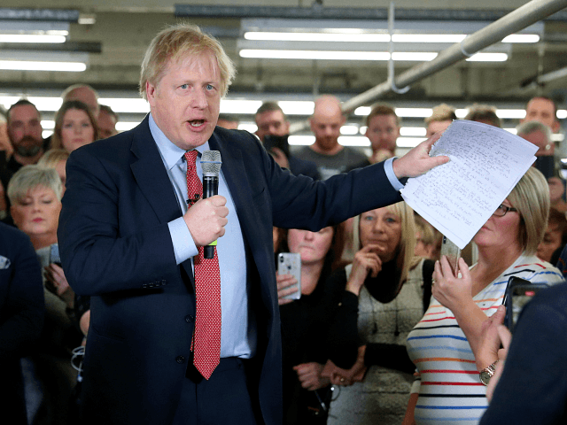 MATLOCK, ENGLAND - DECEMBER 05: UK Prime Minister Boris Johnson delivers a speech during a meeting with workers as he visits John Smedley Mill on December 05, 2019 in Matlock, England. The UK will go to the polls on December 12, the third General Election in less than five years. …