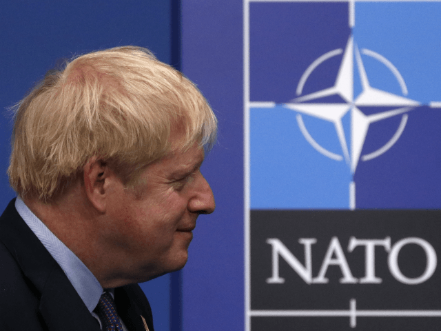 Britain's Prime Minister Boris Johnson waits for arrivals at the NATO summit at the Grove hotel in Watford, northeast of London on December 4, 2019. (Photo by Adrian DENNIS / AFP) (Photo by ADRIAN DENNIS/AFP via Getty Images)
