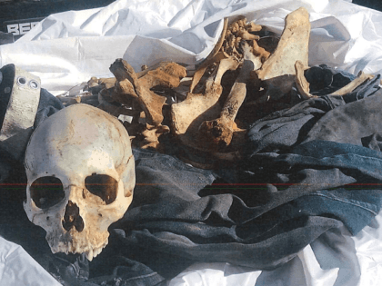 A Brooks County Sheriff's Office deputy recovers the skeletal remains of a migrant who died 80 miles from Texas-Mexico Border. (