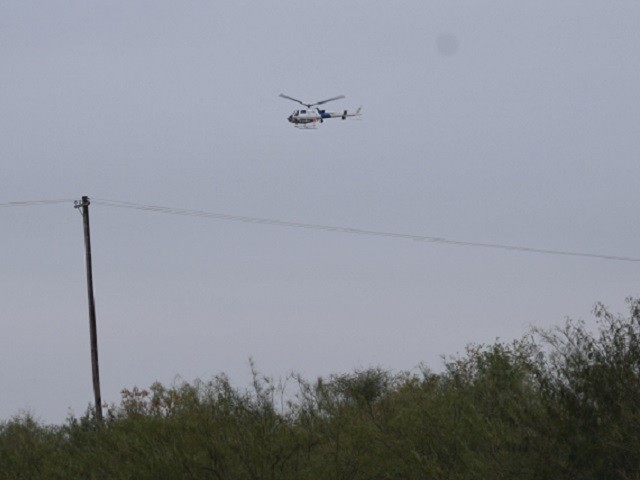 A CBP Air and Marine Operations aircrew provides air cover as Border Patrol agents work to find a group of migrants who just crossed the Rio Grande. (Photo: Bob Price/Breitbart Texas)
