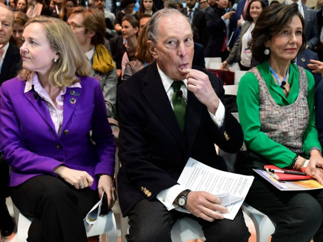 Democratic presidential hopeful Michael Bloomberg (C) sits between Spanish Santander Bank executive chairperson Ana Botin (R) and Spanish careteker minister for economic affairs Nadia Calvino as they attend an event within the UN Climate Change Conference COP25 at the 'IFEMA - Feria de Madrid' exhibition centre, in Madrid, on December …