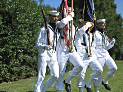 WASHINGTON, DC - JUNE 23: A U.S. Navy honor guard arrives for an award ceremony to honor the victims and recognize the heroic actions of the people involved in the Washington Navy Yard shootings at Luetze Park at the military base June 23, 2014 in Washington, DC. The September 16, …