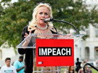 """WASHINGTON, DC - SEPTEMBER 26: Rep. Debbie Dingell (D-MI) speaks at the """"Impeachment Now!"""" rally in support of an immediate inquiry towards articles of impeachment against U.S. President Donald Trump on the grounds of the U.S. Capital on September 26, 2019in Washington, DC. (Photo by Paul Morigi/Getty Images for MoveOn …"""