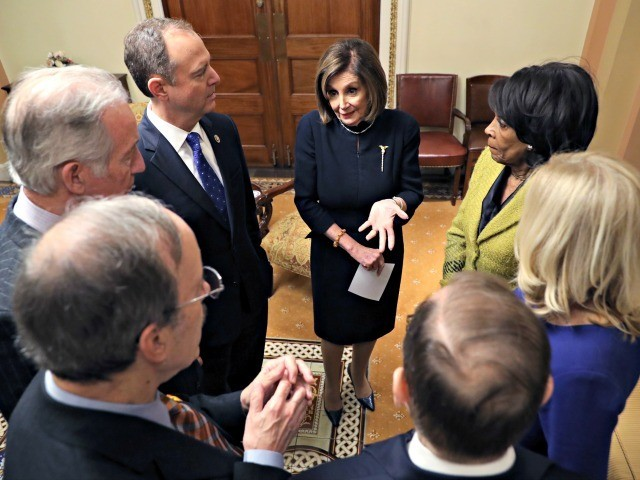 WASHINGTON, DC - DECEMBER 18: Speaker of the House Nancy Pelosi (D-CA) speaks with House Intelligence Committee Rep. Adam Schiff (D-CA) (L) and Chairwoman of House Financial Services Committee Rep. Maxine Waters (D-CA) (R) along with other Representatives in the Speaker's ceremonial office after the second article of impeachment of …