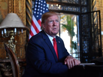 US President Donald Trump answers questions from reporters after making a video call to the troops stationed worldwide at the Mar-a-Lago estate in Palm Beach Florida, on December 24, 2019. (Photo by Nicholas Kamm / AFP) (Photo by NICHOLAS KAMM/AFP via Getty Images)