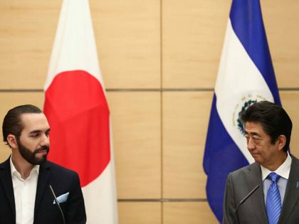 Japan's Prime Minister Shinzo Abe (R) and El Salvador President Nayib Bukele attend a joint press conference in Tokyo on November 29, 2019. (Photo by Behrouz MEHRI / POOL / AFP) (Photo by BEHROUZ MEHRI/POOL/AFP via Getty Images)