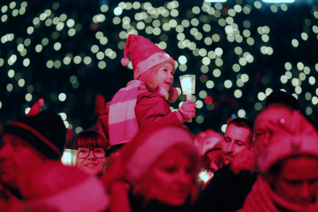 BERLIN, GERMANY - DECEMBER 23: Tarja, age 4, daughter of a fan family of the FC Union football club, which permitted she to be photographed, hold a candle as she sing Christmas carols in the club's stadium on December 23, 2018 in Berlin, Germany. The annual gathering has become a …