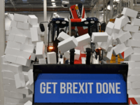 Pics: BoJo Ploughs 'Get Brexit Done' Union Jack Digger Through Wall in Election Stunt