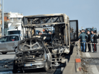 TOPSHOT - The wreckage of a school bus that was transporting some 50 children is pictured on March 20, 2019 after it was torched by the bus' driver, in San Donato Milanese, southeast of Milan. - Italian police rescued some 50 children on March 20, 2019 after their driver threatened …